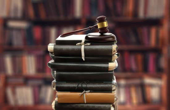 Stack of old paper folders and gavel